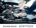 Asian car mechanic in an auto...
