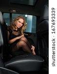 beautiful blonde in the car | Shutterstock . vector #167693339