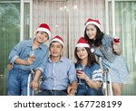 happy family in santa caps... | Shutterstock . vector #167728199