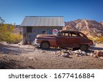 Small photo of Nelson Ghost Town, Nevada, USA - 4 October, 2019: Old classic car next to a small cabin in Nelson Ghost Town, Nelson Cutoff Rd, Searchlight, Nevada, USA