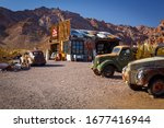 Small photo of Nelson Ghost Town, Nevada, USA - 4 October, 2019: old classic cars in Nelson Ghost Town near Eldorado Gold Mine, Nelson Cutoff Rd, Searchlight, Nevada, USA