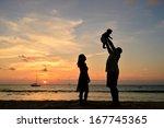 family beach sunset | Shutterstock . vector #167745365