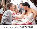 young bride pulling groom by... | Shutterstock . vector #167749787