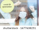 Small photo of portrait of a red-haired girl behind glass in a protective face mask as a concept of quarantine and isolation due to the covid-19 coronavirus, border closure and social disunity
