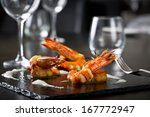 elegant grilled shrimps | Shutterstock . vector #167772947