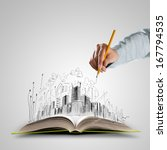 opened book and hand drawing... | Shutterstock . vector #167794535