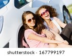 young pretty women sitting near ... | Shutterstock . vector #167799197