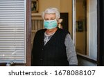 Old Woman With Mask Isolated A...