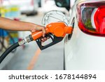Small photo of Man Refill and filling Oil Gas Fuel at station.Gas station - refueling.To fill the machine with fuel. Car fill with gasoline at a gas station. Gas station pump.