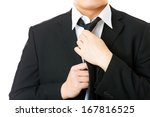 businessman adjusting tie... | Shutterstock . vector #167816525