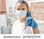 Small photo of COVID-19 Pandemic Coronavirus Mask Woman nurse hospital or home isolation auto quarantine for virus SARS-CoV-2. Girl voluntary isolation surgical mask. Hope signal.. Disease 2019.-CoV-2.