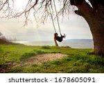 Woman Is Swinging And Enjoying. ...