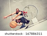 Two Basketball Players On The...