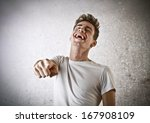 laughing young guy | Shutterstock . vector #167908109
