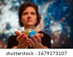 Woman Is Holding Globe With...