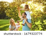 Happy Young Family With...