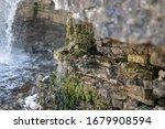 Water Trickling Down Rock Face...