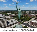 """An early 20th century copper statue, dubbed """"Lady Liberty"""" stands atop the Allen County Courthouse in downtown Fort Wayne, Indiana. The statue is a functioning weather vane."""