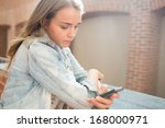 serious student standing in the ... | Shutterstock . vector #168000971