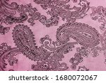 Small photo of texture, background, red, blushing, ruddy, florid, gules, blushful fabric with a paisley pattern. based on traditional Asian elements