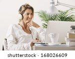 smiling mature woman listening... | Shutterstock . vector #168026609