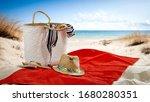 Summer Bag On Red Towel On...