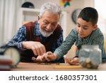 Grandpa And Grandson Saving...