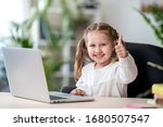 Little Girl Uses Laptop To...