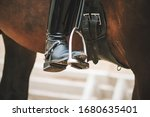 The Black Booted Rider\'s Foot...