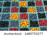Boxes Of Berries And Yellow...