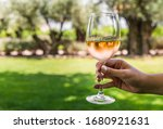 A Young Woman Holding A Glass...