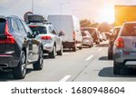 Small photo of Cars rush hours city street. Car on highway in traffic jam on road.
