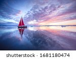 Sail Boat With Red Sails...