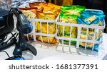 Small photo of Huntington, West Virginia, USA - 02/16/2020: Packets of Miss Vickie's kettle-cooked potato chips stacked by the billing counter