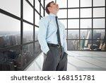 serious businessman standing... | Shutterstock . vector #168151781
