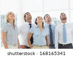 smiling business team looking... | Shutterstock . vector #168165341