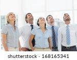 smiling business team looking... | Shutterstock . vector #168165341