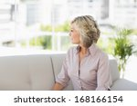 thoughtful mature woman sitting ... | Shutterstock . vector #168166154
