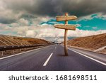 empty wooden signpost on highway | Shutterstock . vector #1681698511