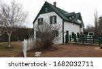 A White And Green Farm House I...