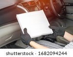 Small photo of Women driver looking air filter in cooling system of car by myself check dust and amiss in Passenger car of car service concept