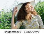 young beautiful girl in hat and ... | Shutterstock . vector #168209999