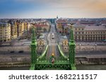 Budapest, Hungary - Aerial view of Liberty Bridge and empty streets at Vamhaz Boulevard (Vamhaz korut), Fovam square and Central Market Hall. No people and quarantine during the Coronavirus disease