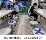 Small photo of Singapore Mar2020 Social distancing rules in practice, alternate seating in local public food courts (restaurants, food outlets), to reduce risk of further transmission; safety measures