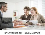real estate agent shows a build ... | Shutterstock . vector #168228905