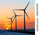 A Group Of Three Wind Turbines...