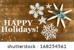 beautiful snowflakes on wooden... | Shutterstock . vector #168254561