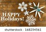 beautiful snowflakes on wooden... | Shutterstock . vector #168254561