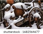 Snow Covered Clay Vessel On An...
