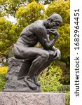 Small photo of TOKYO - 14 APRIL, 2010: Bronze cast of The Thinker by Rodin outside the entrance to the National Museum of Western Art in Ueno Park